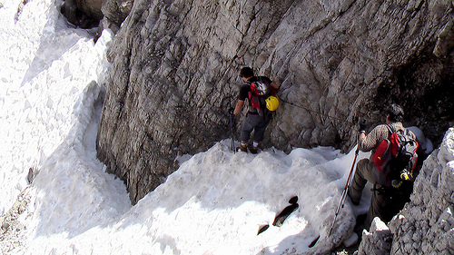 climbers-descending-steep-snow