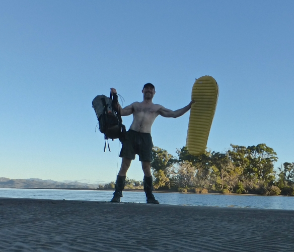 Celebrating after paddling the 150 metres crossing between Piners and Settlement Points on my Thermarest NeoAir. My backpack floated behind, attached with some guyline to my right leg.